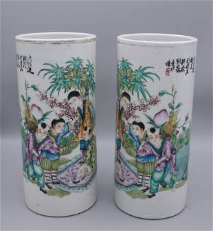 A pair of figure porcelain hat stands