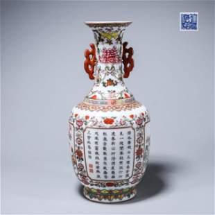 An inscribed famille rose flower porcelain vase