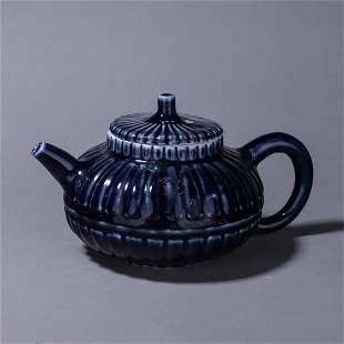 A blue glazed porcelain teapot