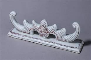 An underglazed red bat porcelain brush stand