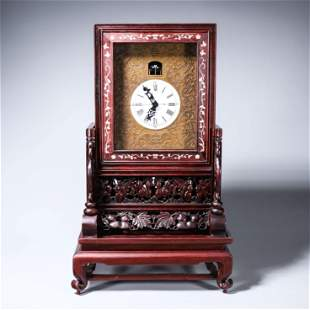 A rosewood raden-inlaid mechanical clock