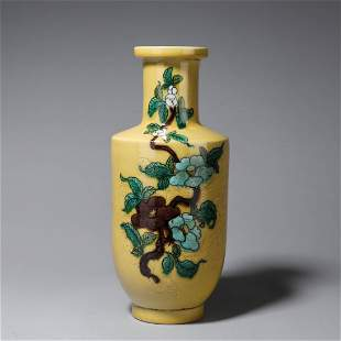 A yellow glazed dragon carved porcelain vase