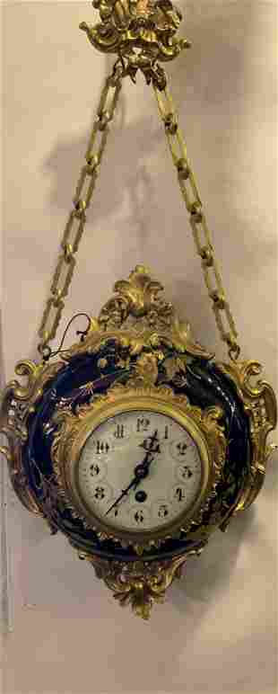 A French Bronze Porcelain Wall Clock