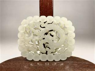 A Chinese Qing Dynasty Carved Dragon White Jade plaque