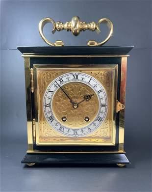 A Fine Cartier Gilt Onyx Luxe Table Clock