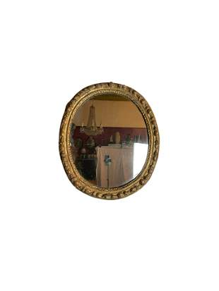 An 18th Century Relief Carved Gilt Wood Framed Mirror