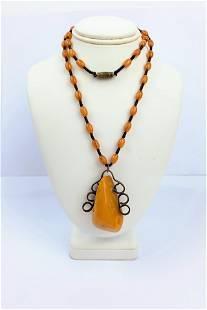 A Butterscotch Amber Pendant Bead Necklace