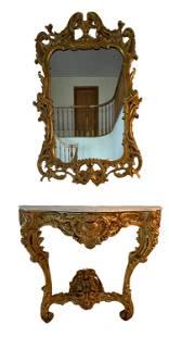 An Italian Rococo Style Gilt Wood Mirror