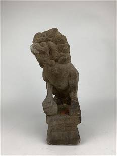 A Chinese Foo Dog Stone Statue