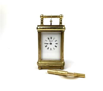 A Marcus & Co. Gilt 5 Minute Repeater Carriage Clock