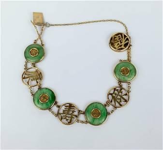 A Chinese 14k Green Jadeite Bracelet
