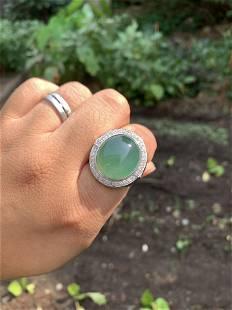 A Chinese GIA Jadiete Diamond 18k Gold Cigar Ring