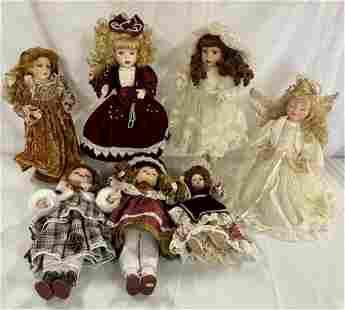 Assortment of 7 Porcelain Face Dolls