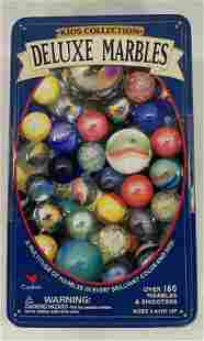 Collection of Marbles in a Tin