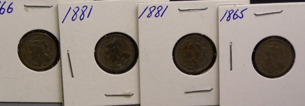 18: FOUR THREE CENT PIECES  1881, 1866, 1881, 1865
