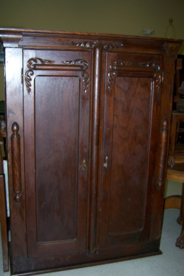 183: OAK WARDROBE WITH CARVED DECORATIONS