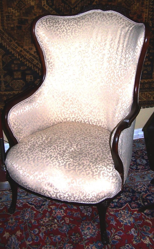 408: WELL CARVED ANTIQUE WING BACK CHAIR