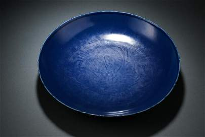 A MING BLUE GLAZED MONOCHROME PORCELAIN CHARGER