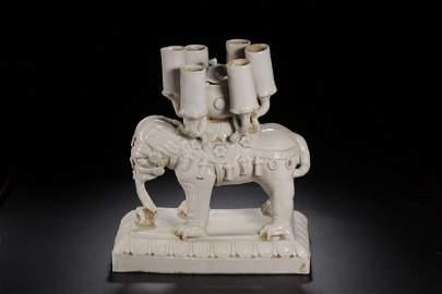 A WHITE GLAZED ELEPHANT PORCELAIN CANDLESTICK