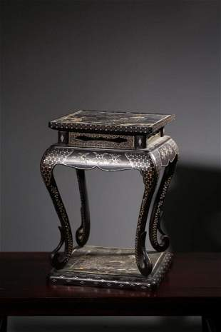 A MOTHER-OF-PEARL INLAID BLACK LACQUER TABLE