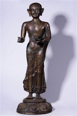 A COPPER STATUE OF UPSTRIGHT GURU BUDDHA