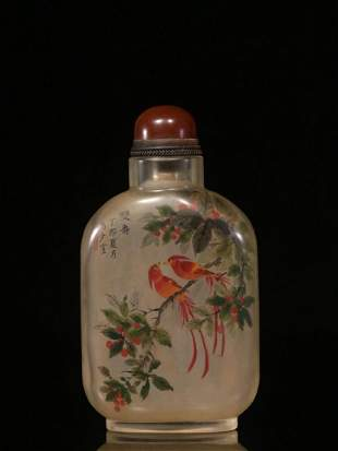 A PEKING GLASS SNUFF BOTTLE WITH BIRD PAINTING