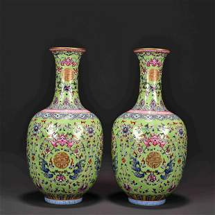 A PAIR OF TURQUOISE GLAZED FAMILLE ROSE VASES