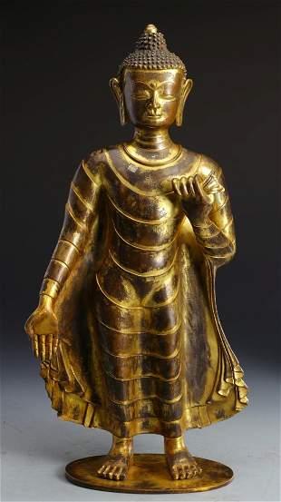 A GILT BRONZE FIGURE OF SHAKYAMUNI BUDDHA
