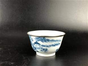 A BLUE AND WHITE PORCELAIN CUP WITH SILVER RIM