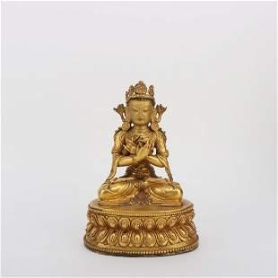 A GILT BRONZE FIGURE STATUE OF BUDDHA ON LOTUS