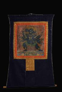 A TIBETAN THANGKA OF MAHAKALA
