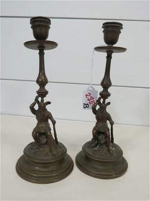Pair of Germanic Figural Bronze Candlesticks