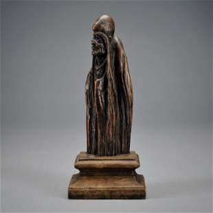 A Carved Aloeswood Standing Figure Qing Dynasty