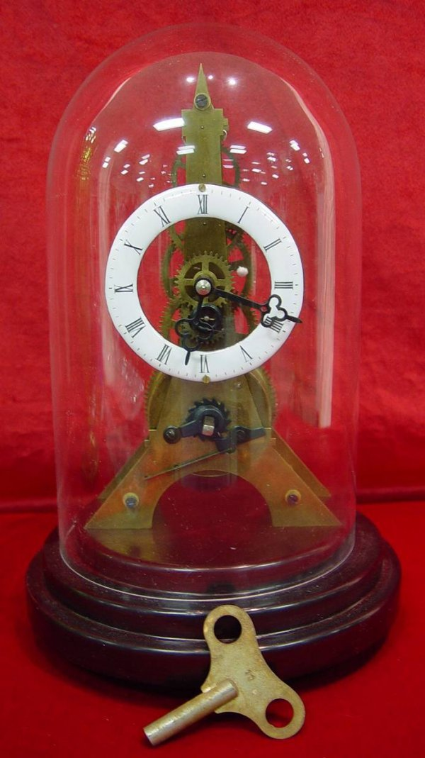 "89: MINIATURE SKELETON CLOCK UNDER DOME 11"" TALL"