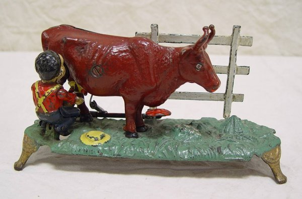 502: CAST IRON MILKING COW MECHANICAL BANK. GREAT CONDI