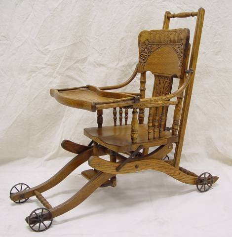 "21: VICTORIAN OAK HIGH CHAIR/STROLLER 39"" TALL 18"" WIDE"