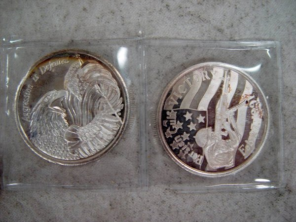608: 2 1 OZ EACH SILVER AGGRESSION IS DEFEATED METALS
