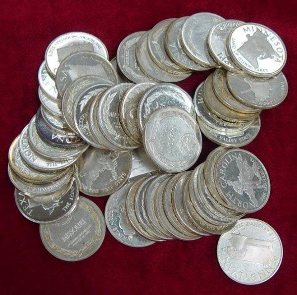611: 50 SILVER COMMEMORATIVE STATE COINS 22 OZ
