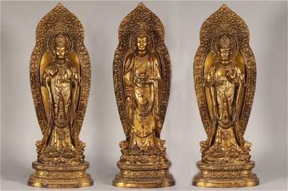 A Group of Three Gilt-Bronze Standing Buddhas Ming