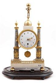 Antique Louis Seize mantel clock in two colors of