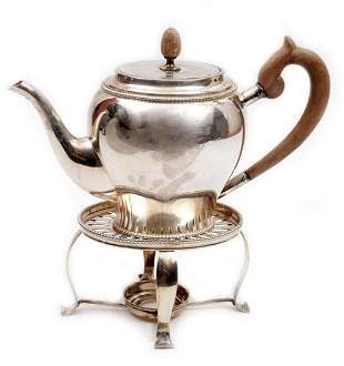 Sterling silver coffee pot with wooden handle with a