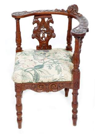 Richly decorated old oak corner chair covered with