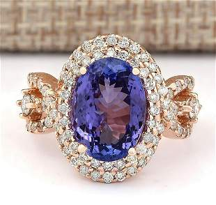 7.02 CTW Natural Blue Tanzanite And Diamond Ring In 14k