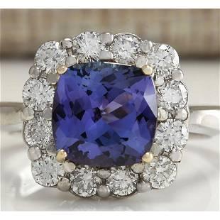 3.93 CTW Natural Blue Tanzanite And Diamond Ring 14K