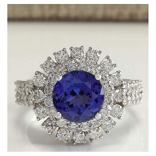 4.03 CTW Natural Blue Tanzanite And Diamond Ring In 18K