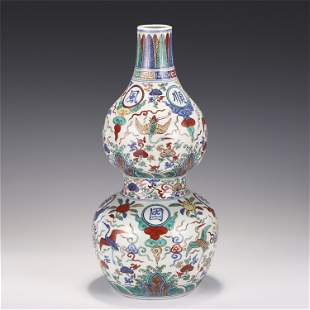 A CHINESE BLUE AND WHITE WU CAI PORCELAIN DOUBLE-GOURD