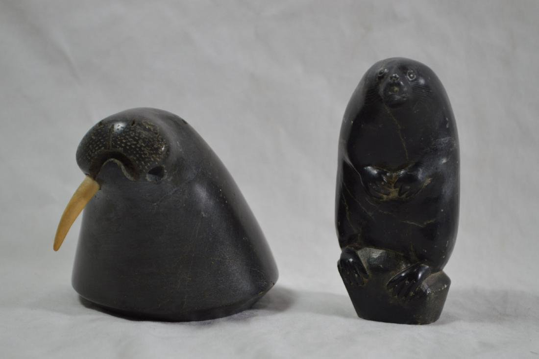 2 SIGNED INNUIT STONE CARVINGS , A SEAL AND A WALRUS