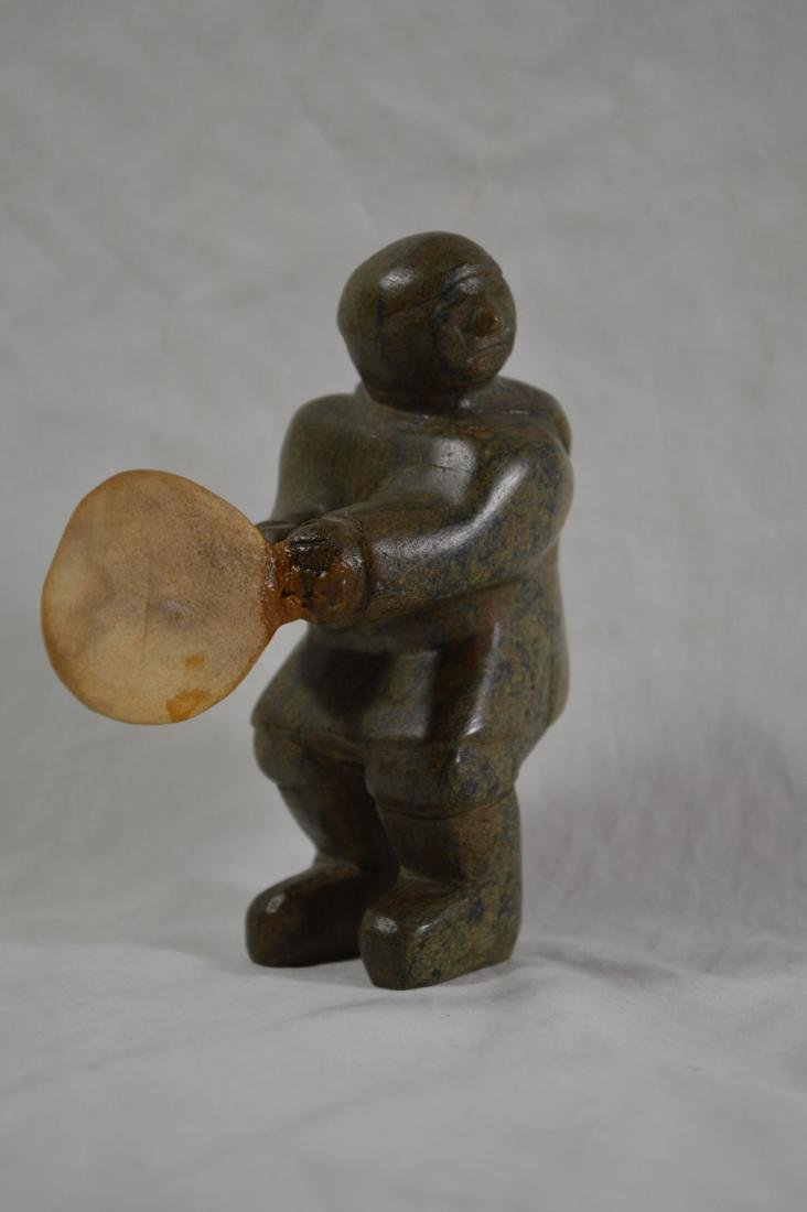 INNUIT STONE CARVING OF A DRUMMER WITH OLD LABEL ON THE