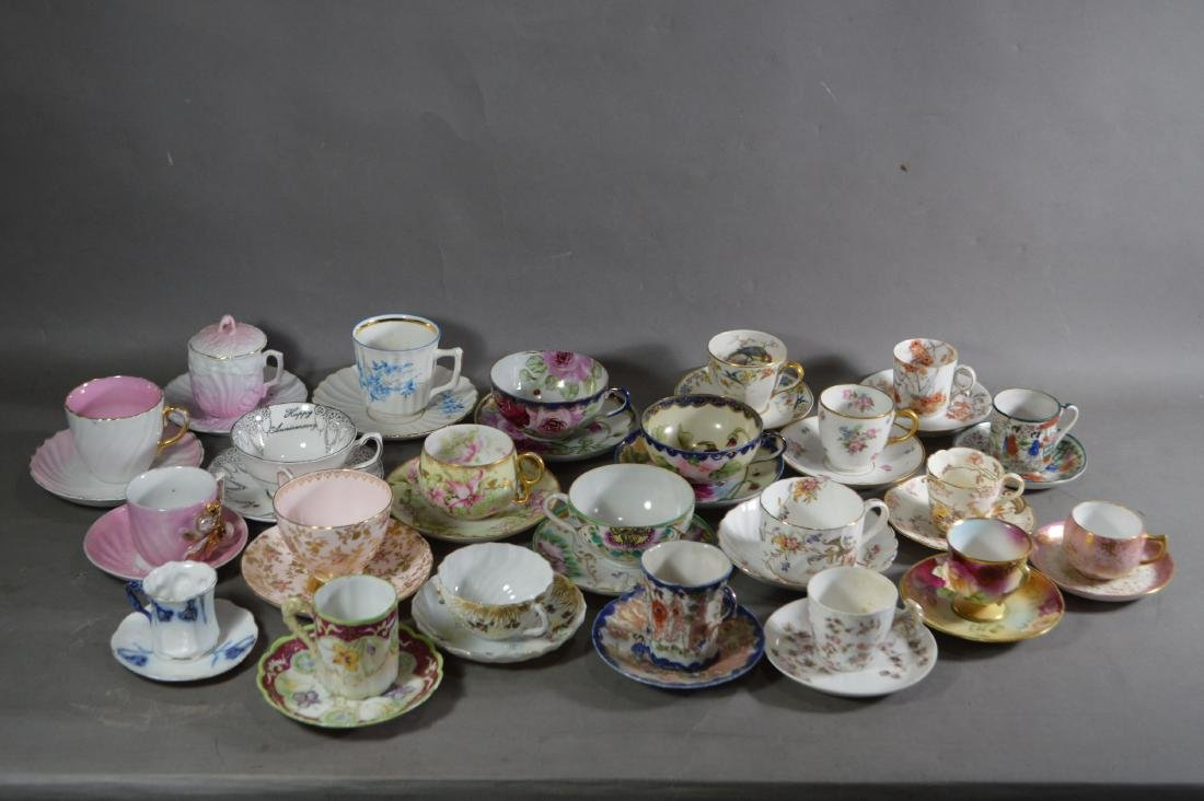 23 ANTIQUE PORCELAIN CUPS AND SAUCERS