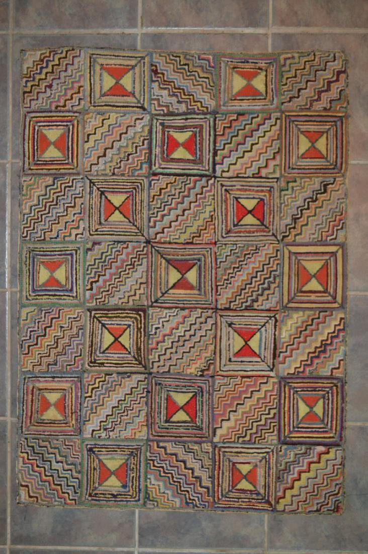 "FOLD ART ANTIQUE GEOMETRIC HOOKED RUG. 42"" x 31"""